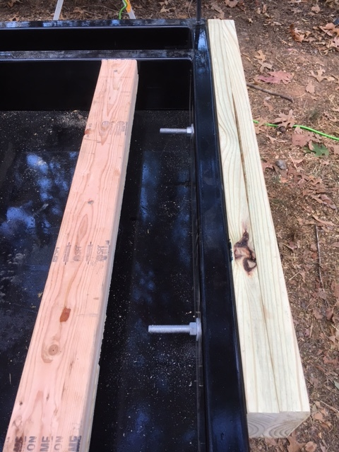 "I gained a few inches on the back of the trailer by attaching 2x6s to the frame of the trailer with 1/2"" lag bolts."