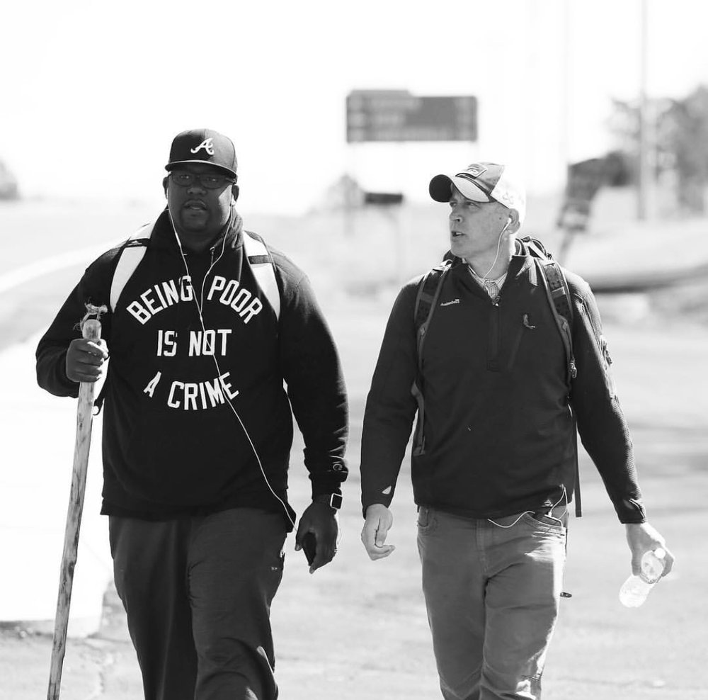 Love Beyond Walls' founder, Terrence Lester, and me, walking through rural Alabama to raise awareness for those experiencing homelessness and poverty.