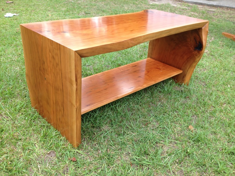 Live-edge cherry slab coffee table designed and built by Michael Sanders from a tree harvested on Saint Helena Island.