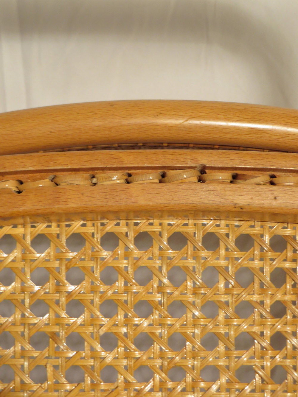 The cane on the Knoll chair is hand woven.