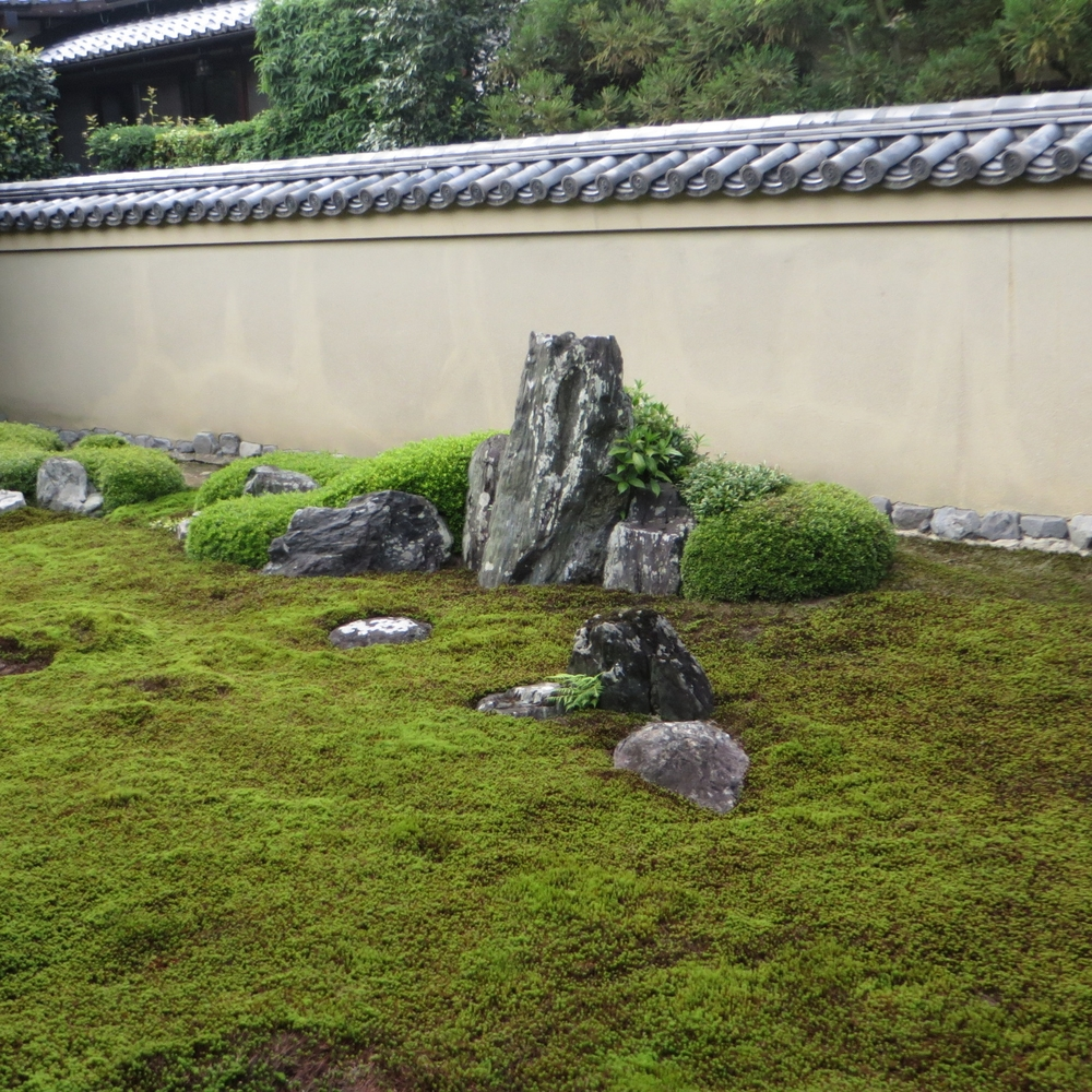 garden wall with rock base and tile cap.JPG