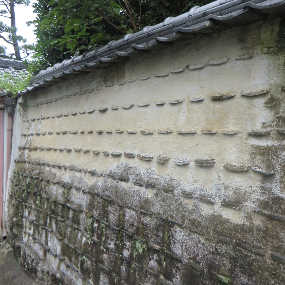 roof tile & stucco wall.JPG