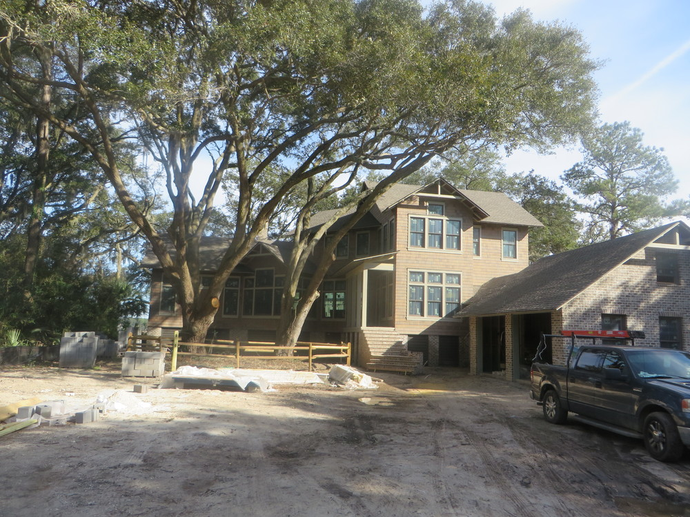The project in Long Cove Club is a little over halfway completed. The neighbors all comment on how nicely the house fits between the trees.