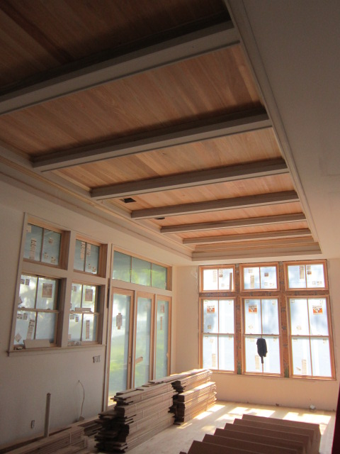 Cypress coffered ceilings downstairs bring warmth and vibrancy to the rooms.
