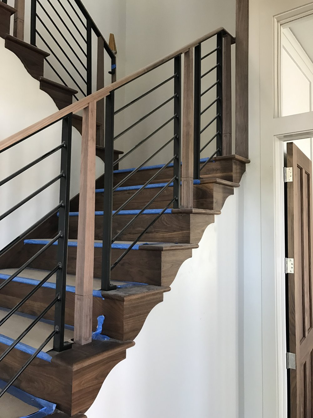 The walnut and iron stair rail looks great!