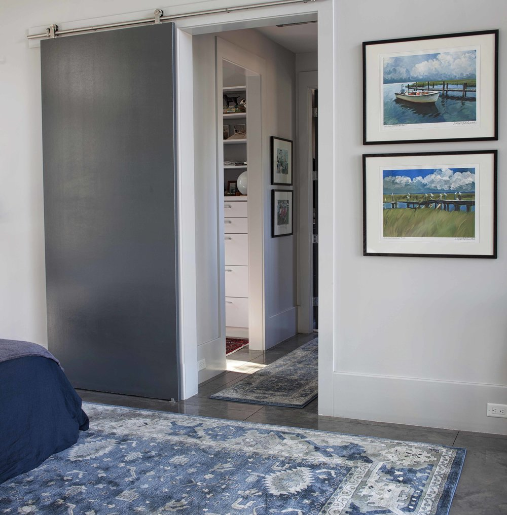 master bedroom in blue and gray
