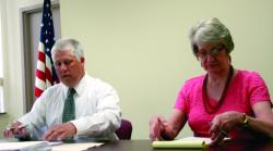 Photo by Joseph Bell – Elk County Commissioner Daniel R. Freeburg, left, reaches for paperwork Tuesday alongside fellow Commissioner Janis E. Kemmer.