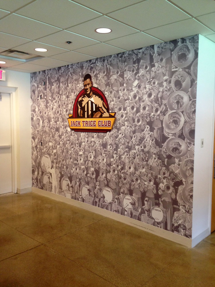 Jack-Trice-Club-dimensional-cutout-on-wall-wrap.jpg