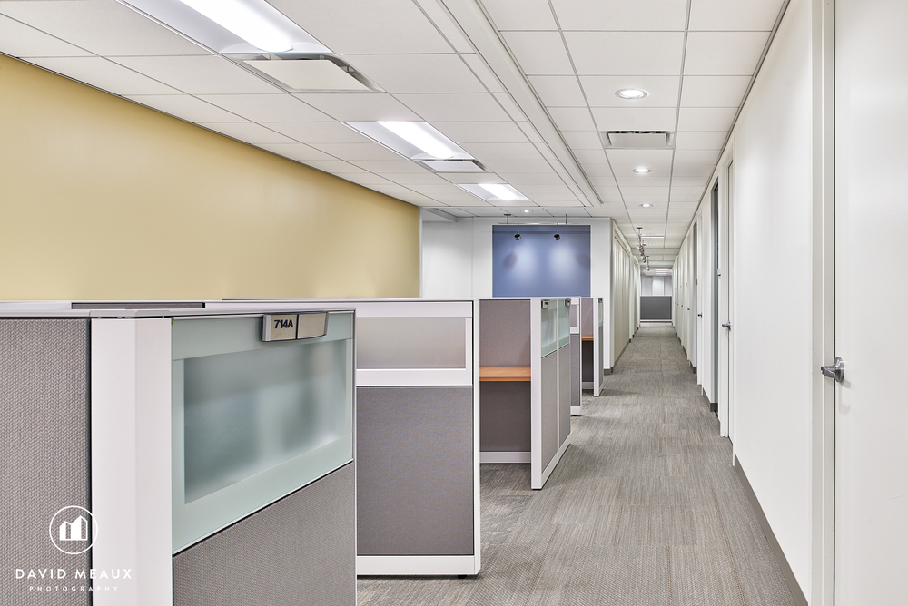 Final edited, color corrected, retouched image of cubicles. We removed the plant, filing cabinets and printer and closed all the doors to make the space feel clean, open and crisp.