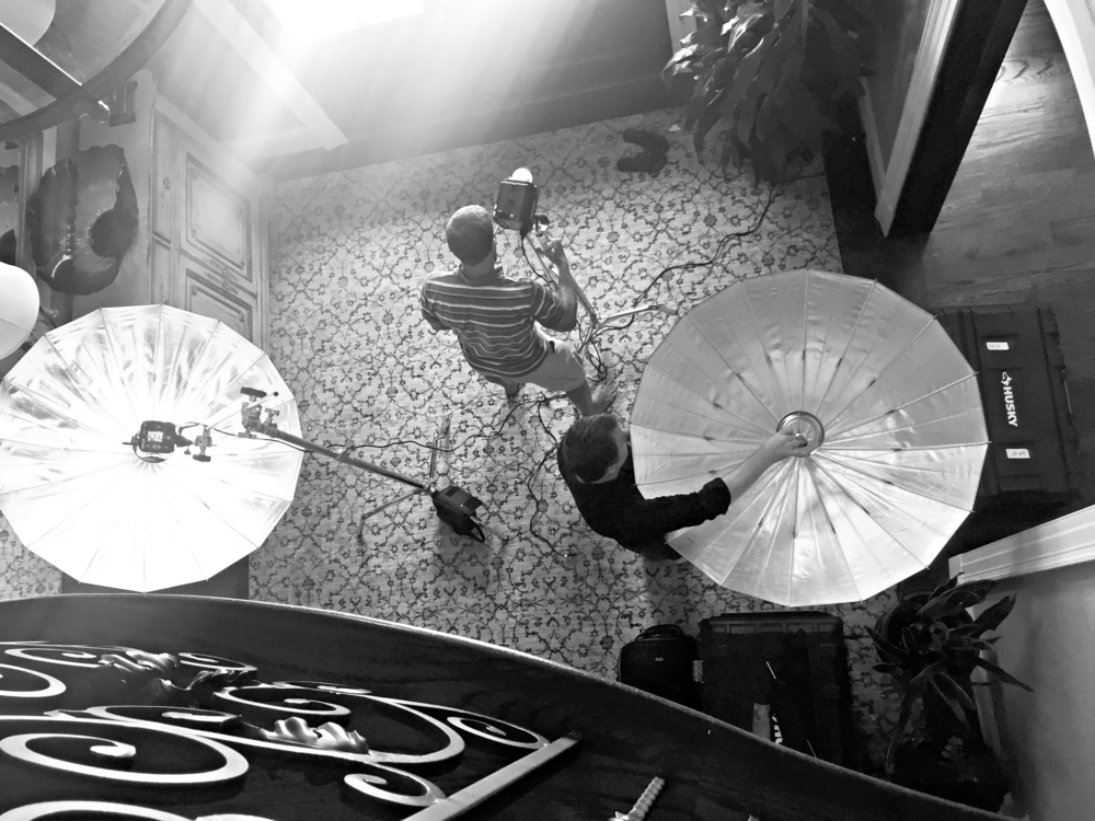 In order to light up the walls near window, we had to position two light units with umbrellas to bring in some light and fill in the shadows in the ceiling and walls in the image.