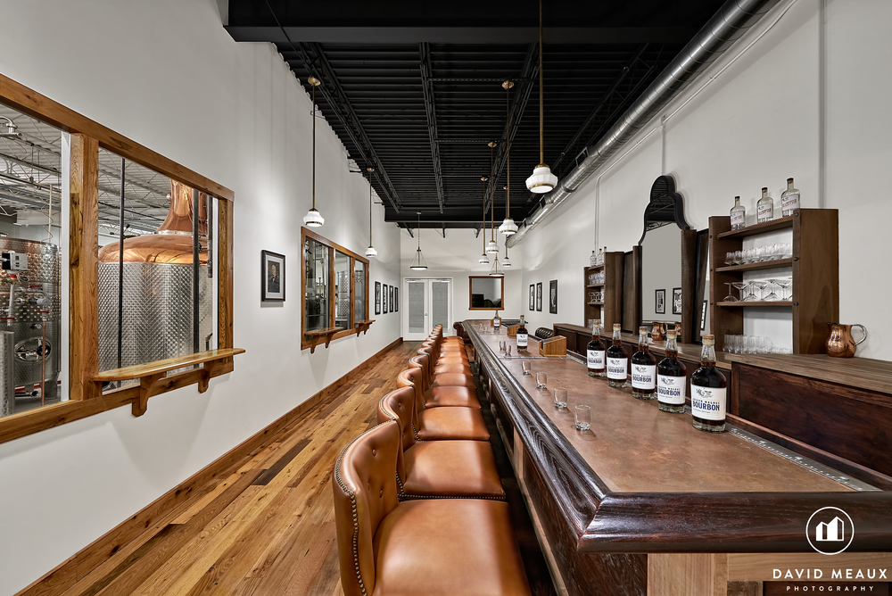 The Murray Hill Club offers visitors a copper-topped bar, leather sofas and views of the stills.