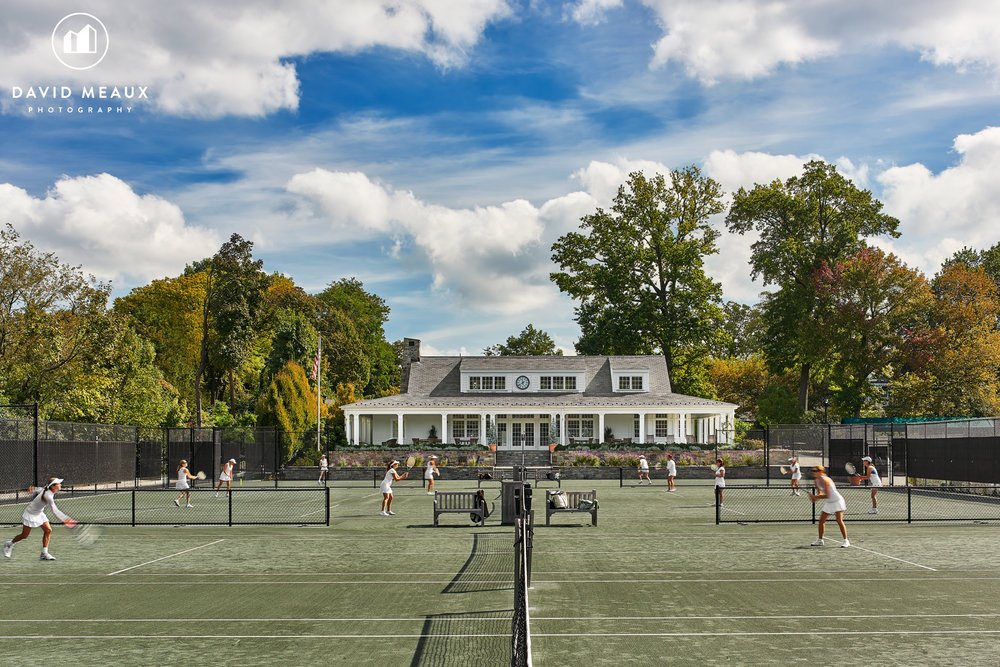 Daytime photo of the Tennis Center with members playing Tennis, Chevy Chase Club, MD.