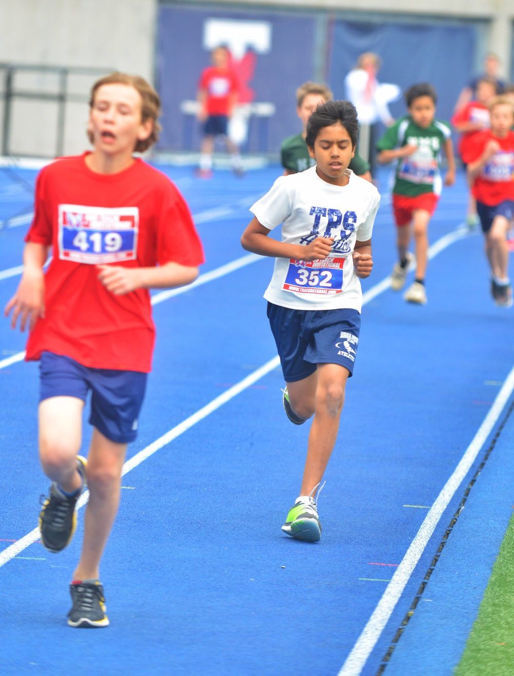 Chasing down second place in the Boys U-12 400m.