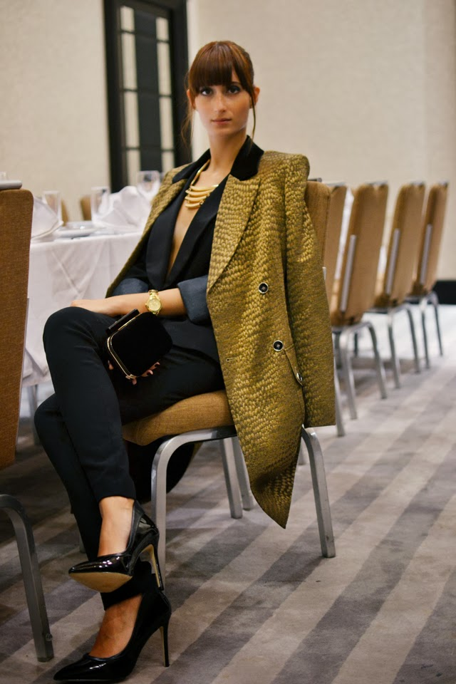 Label C   coat;  Mei Boutique  dinner jacket, trousers and clutch bag;  Aldo  shoes and necklace