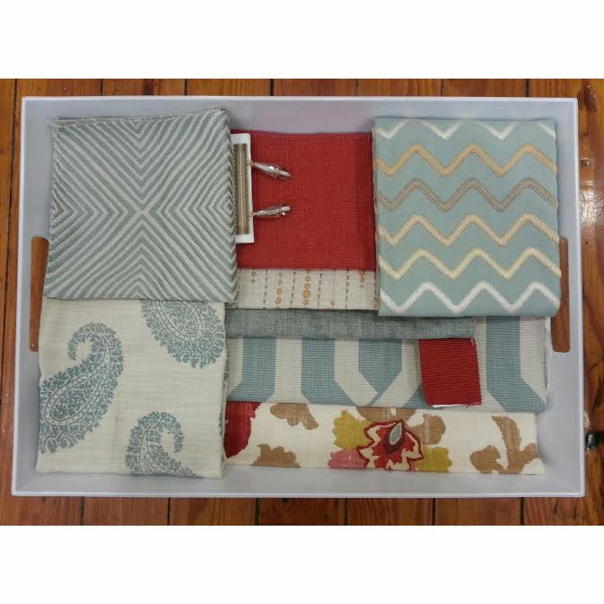One of Lisa's favorite things: PATTERN MIXING! Watery blues, golds and cayenne make these patterns play well together. All of these fabrics will be evenly displayed throughout the home through use of drapery, furniture, pillows etc.