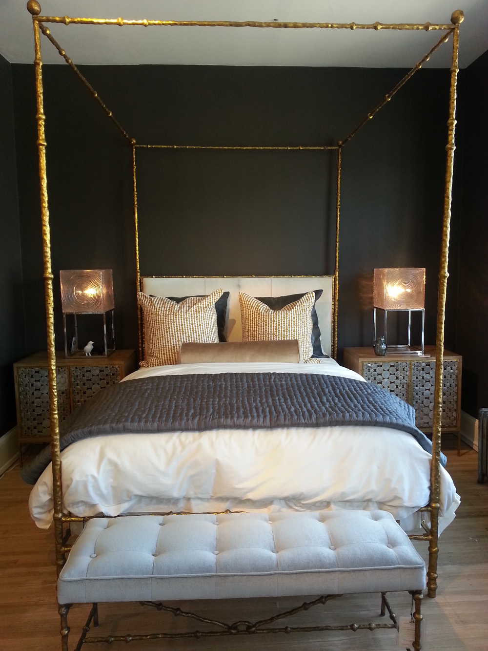 A gold four poster bed, yes, please.