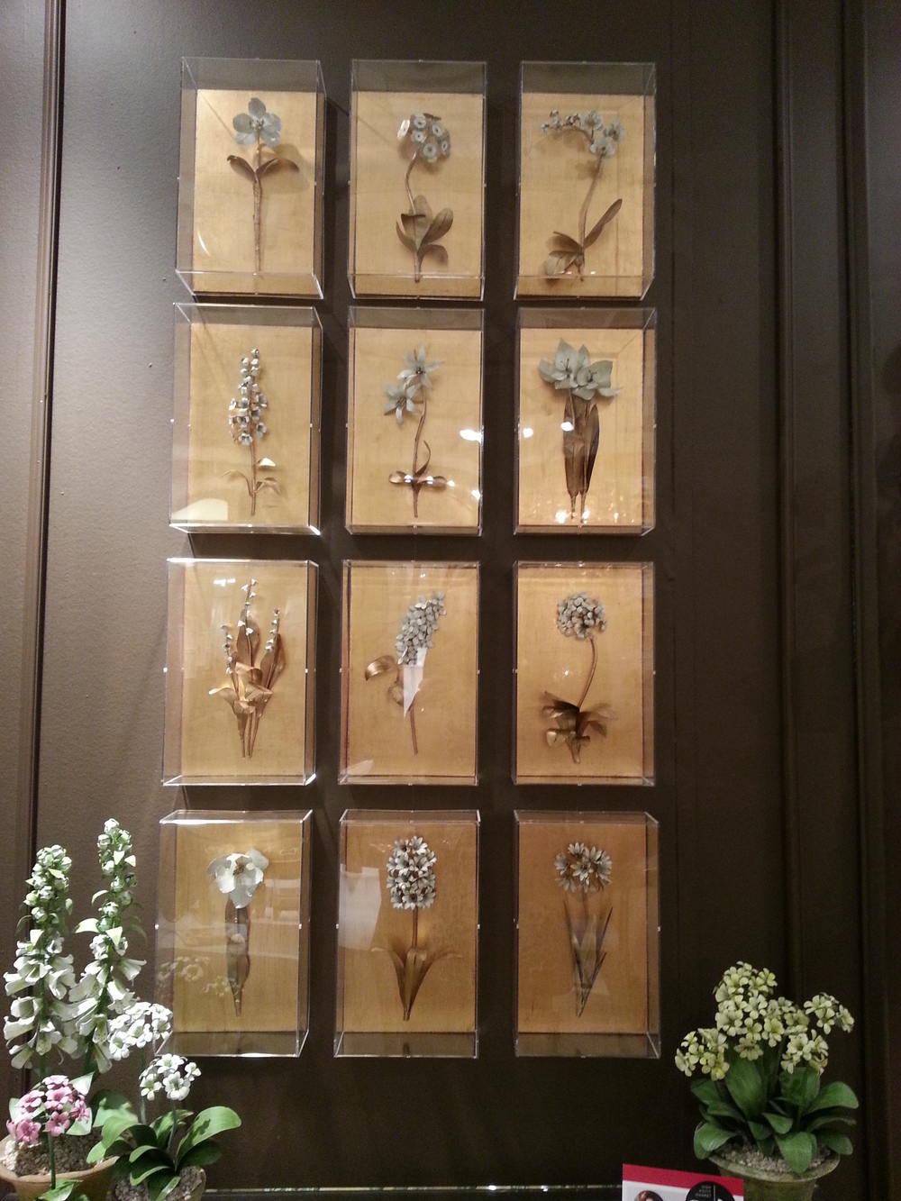 Incredibly chic flowers made from brass and hand painted. Such a beautiful display!
