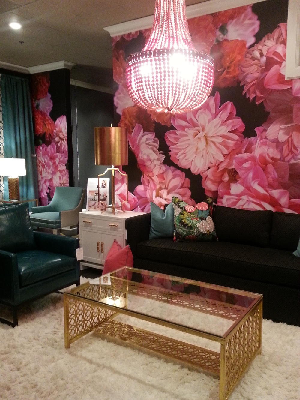 There is so much color going on in this vignette. Through wallpaper, fabrics, lighting, it's just an explosion of happy color. I really enjoyed being in this space. (Another awesome vignette by CR Laine)