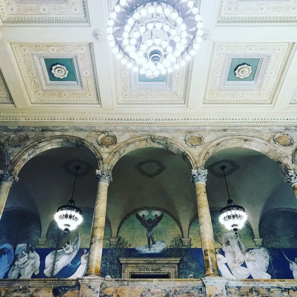 Interior marble archways, chandeliers and John Singer Sargent murals of the Boston Public Library. LGD Team (Crystina Castiglione Photography).