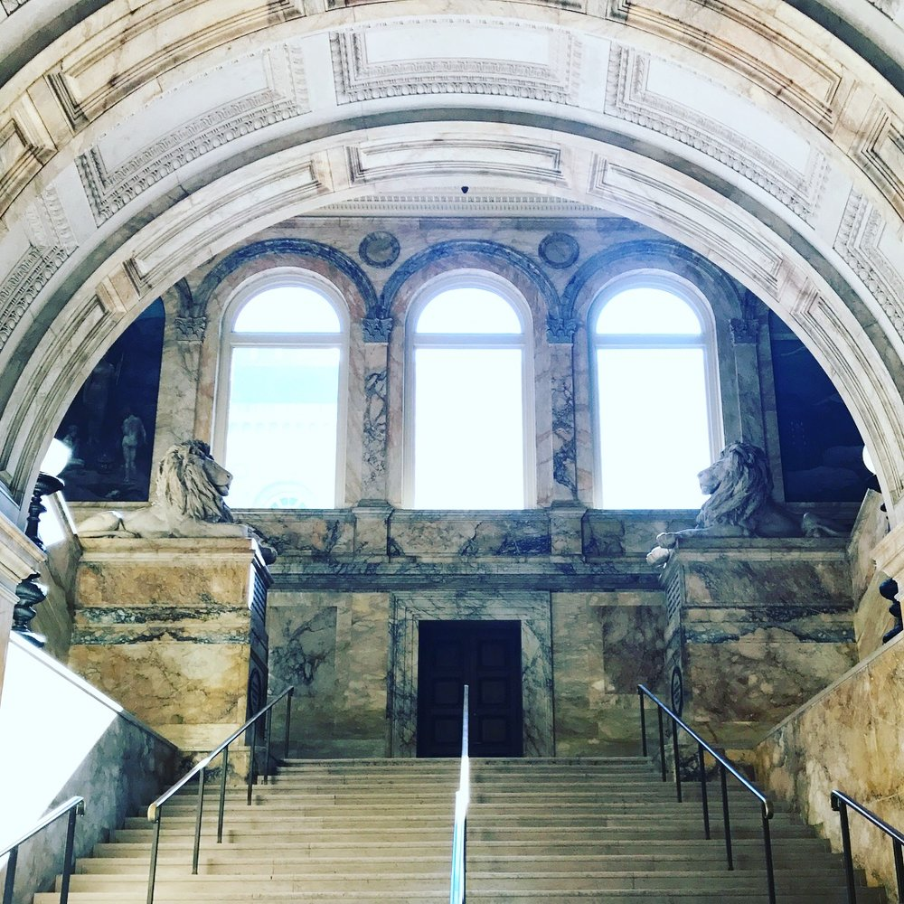 Interior grand foyer marble staircase and archway of the Boston Public Library. LGD Team (Crystina Castiglione Photography).