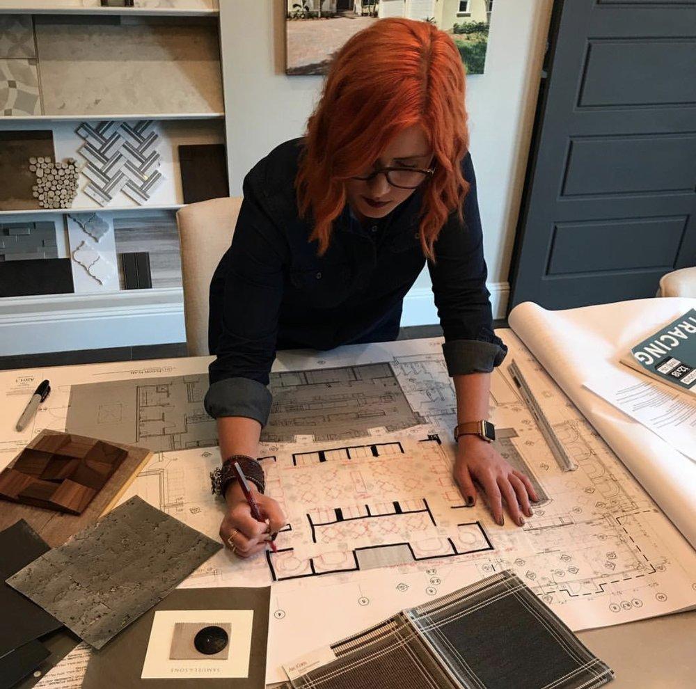 Lisa redlining floor plans and editing materials for a restaurant project. | Lisa Gilmore Design