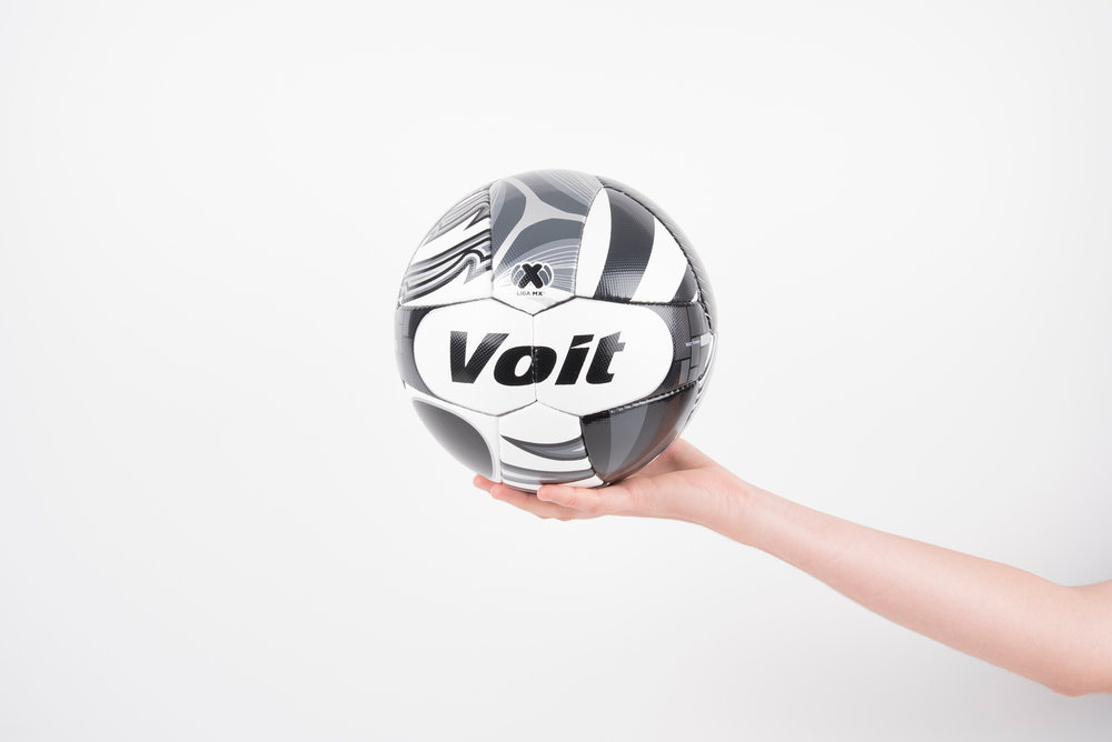 2016 / Limited Edition Soccer Ball / Client:  Voit  / Project Assistant: Fernanda Leal     Voit is a Mexican brand, pioneer in sports equipment development. In 1986, it was the official ball for the Football World Cup in Mexico. That exact year, Voit allied with the Mexican Football League, becoming the official ball and participating in every season since then.  This year is the 30th anniversary of this alliance. To celebrate, a commemorative, limited edition ball was designed retaking all the years of Voit's history in the court. The concept of this ball emerged by getting together fragments of the balls used in the tournaments of the last 30 years, with a recompilation of memories and capturing them in each segment of one ball. It has harmony due to the colors, that resemble to the ones used in the first balls launched by the brand, which were black and white, resulting in a monochromatic language.