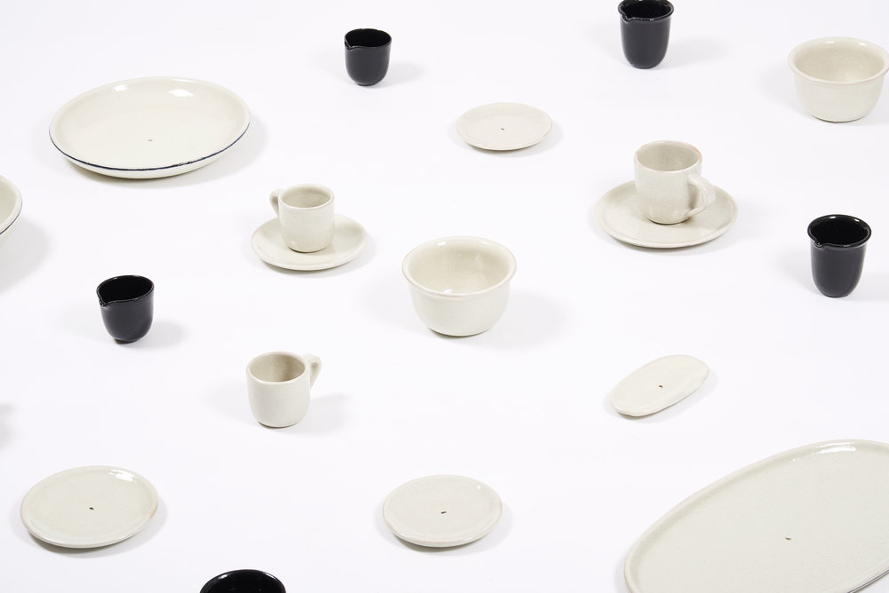 2017 / Client:  Pujol  / Ceramics / Project assistant: Fernanda Leal & Lucas Elizondo / Photography: Studio Moisés Hernández and  Araceli Paz .   This tableware was designed exclusively for Pujol, a restaurant that belongs to Chef Enrique Olvera. This restaurant was opened seventeen years ago in Mexico City. Since then, it has gained international recognition, such as Best Restaurant in México, according to Latin America's 50 Best Restaurants of 2016 and the 20th place in the World's 50 Best Restaurants of 2017. This exact year, Pujol's location and concept was changed. So the tableware had to change too to match with it. The dishes had to be simple to exalt the food.  The tableware is composed by twenty pieces, which are enameled in white and black and have rounded edges and soft curves. Some of them have subtle details that were inspired by the ancient pottery from Oaxaca, such as the handles and the curled out edges. Also, each plate has in the center a blob of black diluted enamel and some of the dishes have a black line in the border where you can see the craftsman stroke. This elements were handmade, so they have a unique, imperfect and elegant personality.  Uriarte Talavera was in charge of the production. This enterprise, which opened in 1824, has the oldest talavera factory. It is a kind of ceramic traditionally decorated with blue patterns painted by hand. This material has appellation of origin. It has to be manufactured in Puebla for it to be certified. For this reason the factory is located there.  Moisés Hernández Studio worked as a creative link between high prestige restaurant as Pujol and a factory of great tradition as Uriarte.