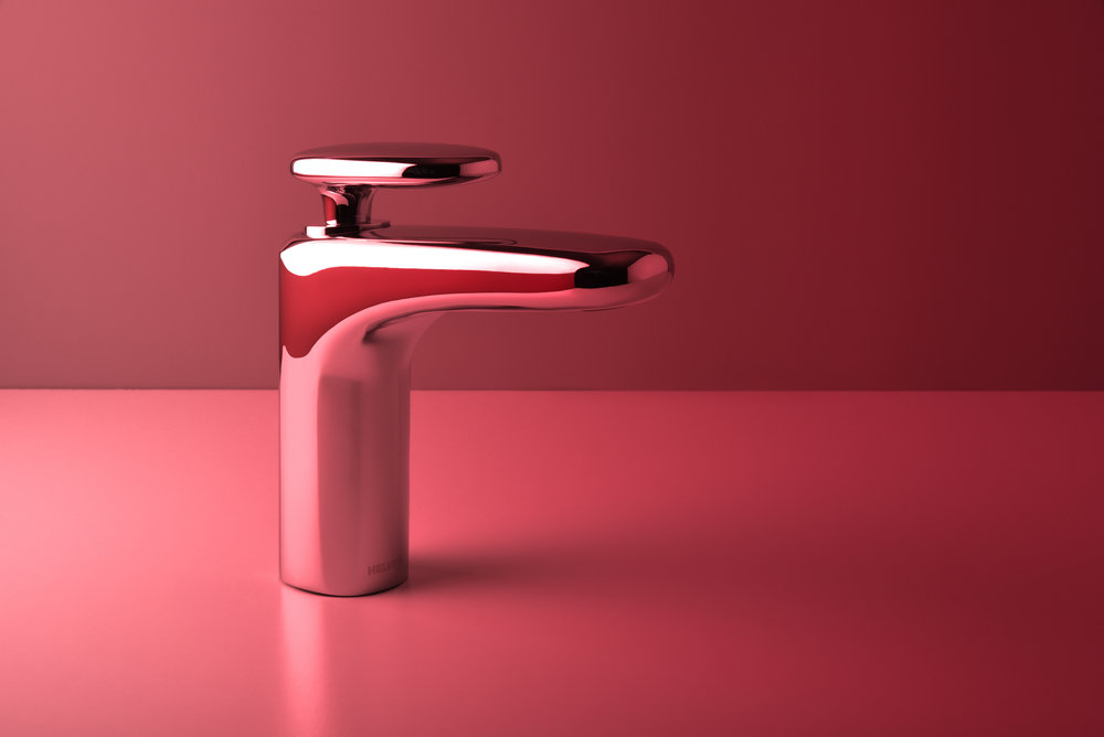 2018 / Client:    Helvex    / Chromed Brass / Project assistant: Lucas Elizondo   A water faucet for commercial and residential areas for Helvex, the most important sanitary fittings and accessories manufacturer in Mexico. Being a company that supplies faucets for the majority of the mexican market and also sells internationally, products with a high manufacturing efficiency are required.  Searching for natural elements found near bodies of water we found that river stones have beautiful curvatures that soften our perception and are ideal for sanitary environments. The continuous surfaces taken from these rocks simplify the production process and give an overall appearance of kindness and gentleness.  With an atemporal language and non-protagonistic volumetry, this faucet blends perfectly with other Helvex products and bathing spaces.