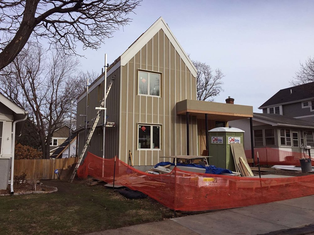 This is the northwest corner.  The fiber cement board-and-batten siding will be painted a dark blue, with white trim.