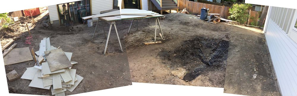 The backyard is another hardscape of overly packed soil.  A future rain garden can be seen hinted at on the right.