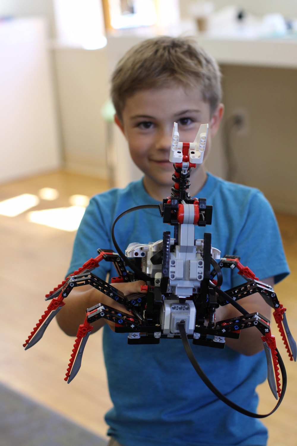 Showing off a completed LEGO EV3 robot.