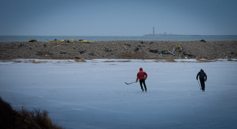 7:00 a.m. | Pond hockey with Petit Manan Light in the distance.