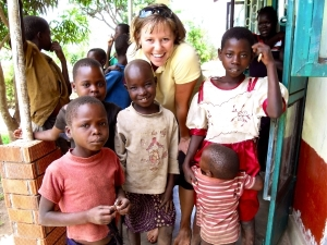 One of our founders, Kathryn, with several of the children that the United African Orphans and Widows Fund works to support.