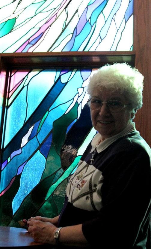 Sr. Lucia at the window she designed at Ursuline College