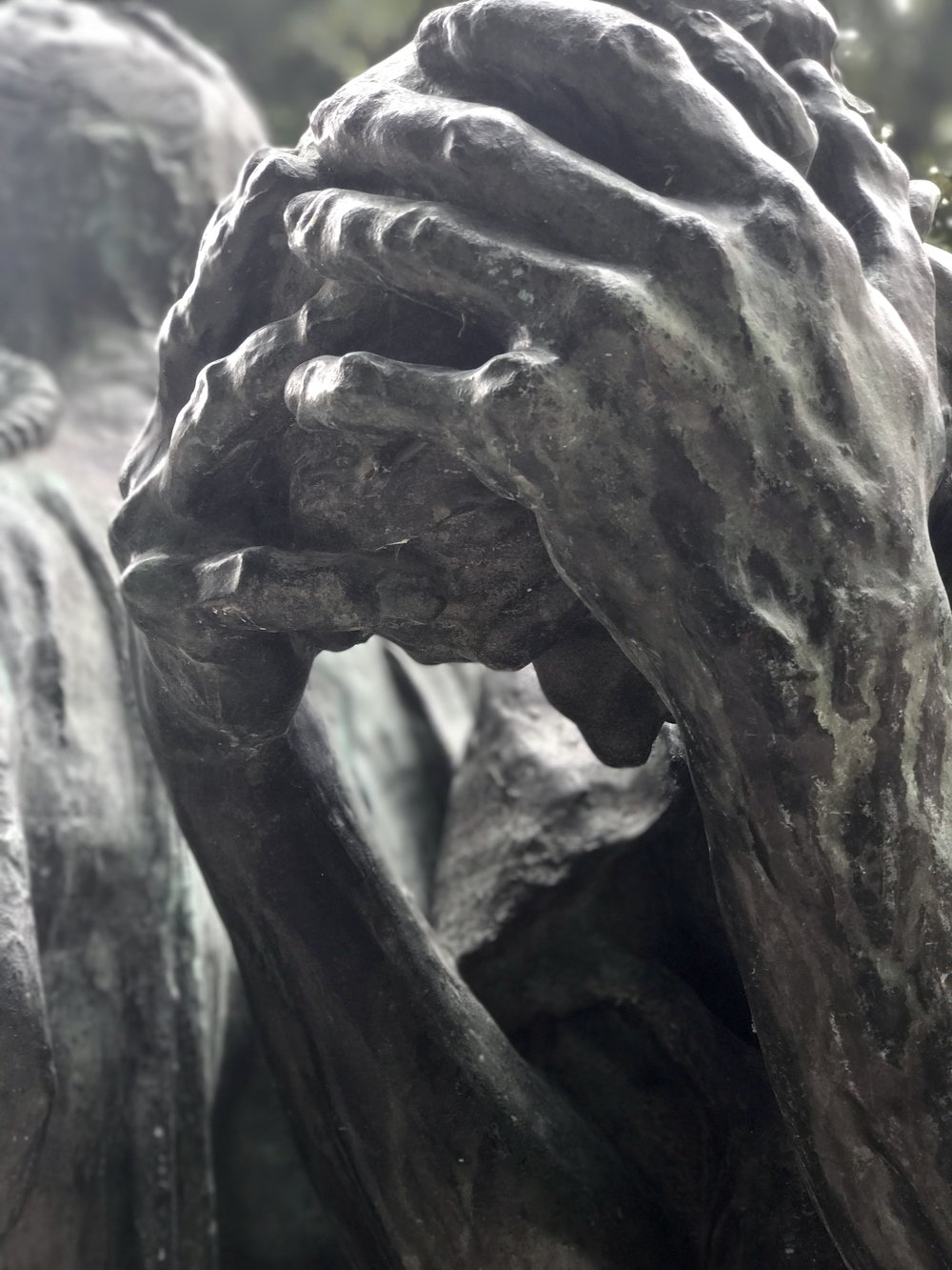 A close up on one of Rodin's Burghers of Calais - a great visual for the feeling of lack - his head hangs so low, he can't even see his options!