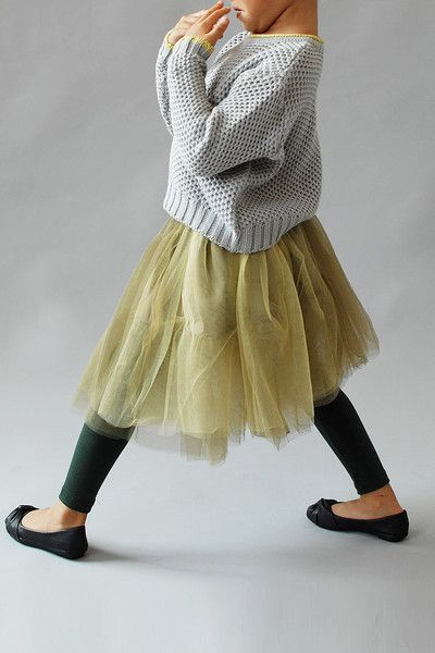 A Beautiful alternative to the Classic Pink Tutu is this Olive Bellanie Tutu from Wunway.com ($49.00).  It is truly a Tutu Skirt for Little Fashionistas-  this airy Tutu features layers of tiered ruffles and has a corsage accent on the waist for Extra Cuteness.  I also love how it is worn with a casual grey sweater, black leggings, and black ballet flats… Tres Chic!