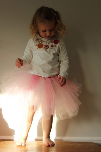 For you Crafty and even Not So Crafty Moms,  The Imagination Tree  has an extremely thorough tutorial on how to Make this Easy No Sew Tutu- which includes straightforward step-by-step, easy to-follow directions and photos.  And Yes I wrote that right... No Sew… and all it takes is about 30 minutes to complete. I don't know about you… but that is my kind of Project! I love this Tutu, as you can make it one solid color, two colors, or even a rainbow of colors to reflect your own daughters favorite colors &  personality.