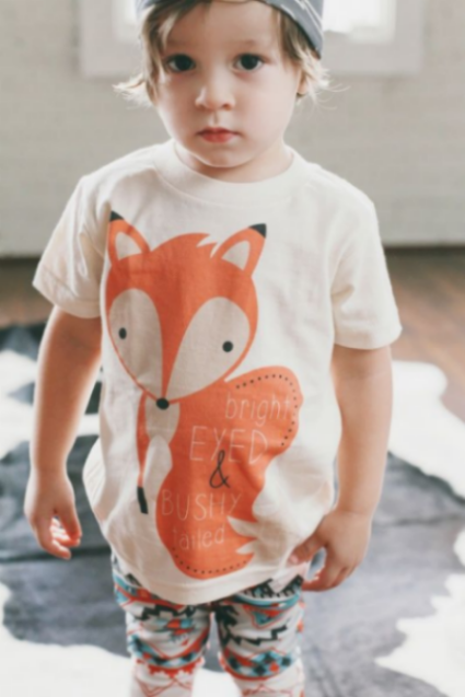 I am obsessed with this  Kindred Oak Bright Eyed and Bushy Tailed Unisex Tee . With Foxes as Popular as they are, this Tee is sure to be a compliment snatcher, and your Child will love it too with the darling Oversize Fox Graphic that is Great for a Boy or a Girl..as the above 2 photos show! I also love that this Tee is 100% Organic Cotton with Water Based Ink.