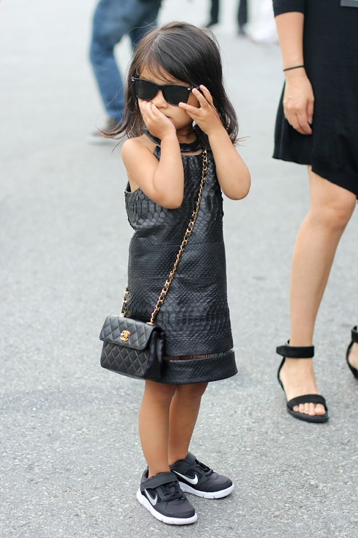 Aila Wang Pairs her Nike Free Sneakers with a Leather Dress and a Kid Sized Chanel Bag