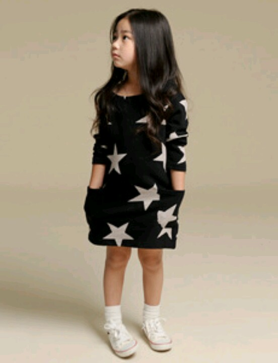 This NUNUNU  Black Star Dress has long sleeves, raw edging, and Allover Star Print. NUNUNU is known for their cool star prints, and I love the ease and versatility of the T-Shirt Dress.