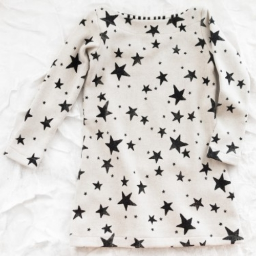 This Noe & Zoe  Deep   Black Stars Dress  is a sailor tunic dress with a clean finished boatneck and is hand printed with deep black stars. Noe & Zoe is another brand known for their Star Prints, and they use the highest quality knit jersey that has a beautiful hand feel and is a blend of cotton and wool. This is truly an amazing Dress!
