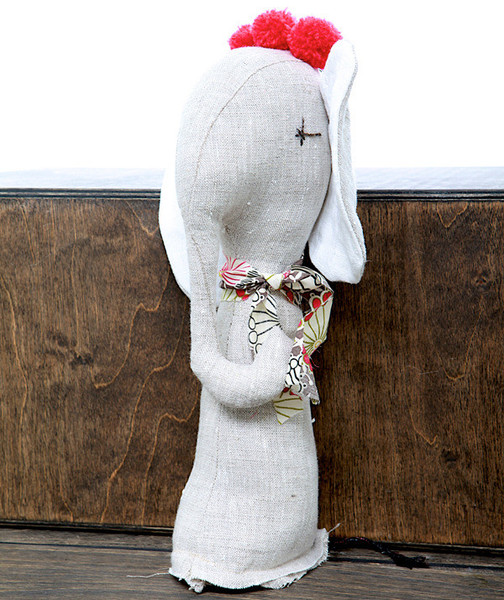 The Jess Brown  Elephant  is made out of linen with assorted seasonal details.