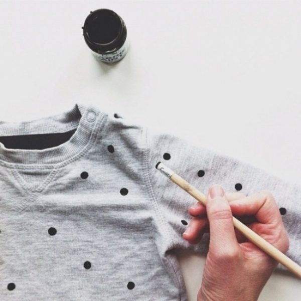 I Love the Simplicity of this DIY Allover Polka Dot Print on a Kids Sweatshirt. Simply buy fabric paint, dip the eraser end of a pencil in the paint, and place dots on a Sweatshirt! How easy is that? I have to try this DIY for my son and for myself! Just don't forget to place a layer of cardboard or scrap paper between the fabric layers of the sweatshirt to prevent the ink from bleeding through! And if you're using a fabric paint that requires heat setting, turn the sweatshirt inside out and place scrap paper between the layers of fabric, then press according to the instructions on the paint package.