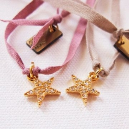 This  ATELiER ATSUYO ET AKiKO Star Dia Ribbon Necklace  is a beautiful sparkly brass star charm on a rose or beige cotton cord.  It will make your Little Ice Princess feel as though she just won gold when she wears it! I love it so much, I am thinking of purchasing it, as I think it would make a cute bracelet with the ribbon wrapped around your wrist!