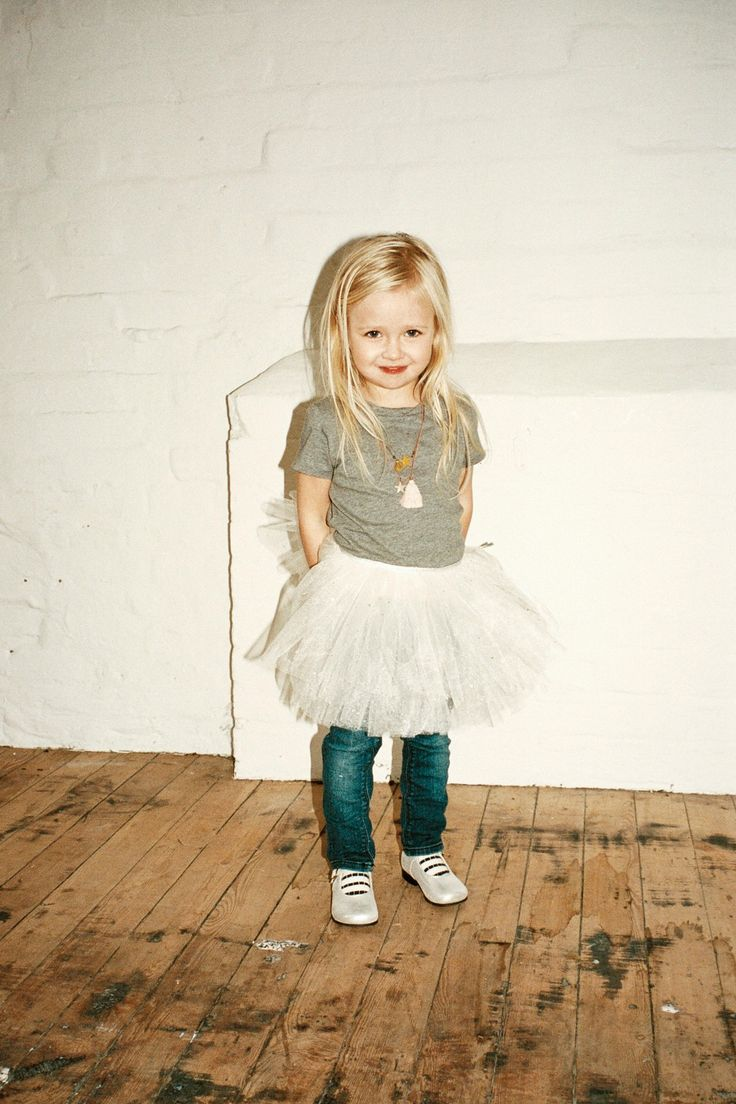 A Statement Making Necklace & Tutu are an adorable way to dress up a T-Shirt & Jeans!