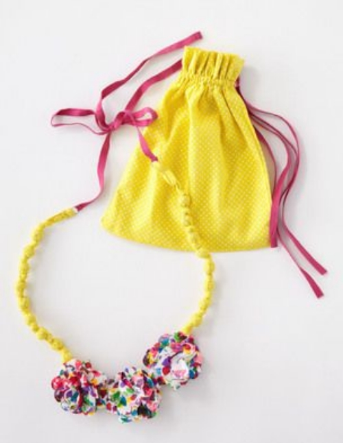 This fabric necklace is a lovely necklace that comes in matching printed bags. There are three strikingly different options, each of which is as cute as the next, and will make a Statement to your little girls outfit.