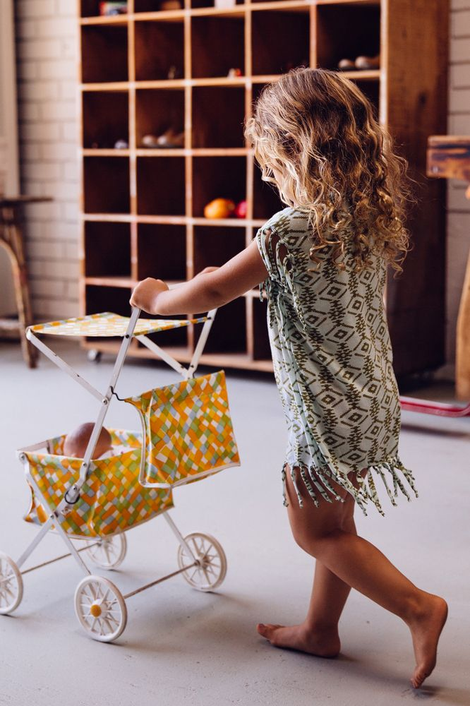 This Arnhem Child MARLOWE TASSEL TEE OLIVE SAHARA ($36.04) is an easy-wear, comfy and super stylish t'shirt that can be worn with leggings, or worn as a short dress on a hot day in Arnhem's striking Olive Sahara print, with playful tassels around the arms and hem.