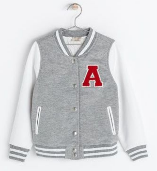 "This Zara CONTRASTING JACKET WITH FAUX LEATHER SLEEVES ($39.90) is a cute and cool girls jacket with traditional varsity details of snaps at the front, ""A"" embroidered patch at left chest, and striped ribbed neckline, cuffs and hem.  It is available in 2 different colors; grey marl (above) and blue."