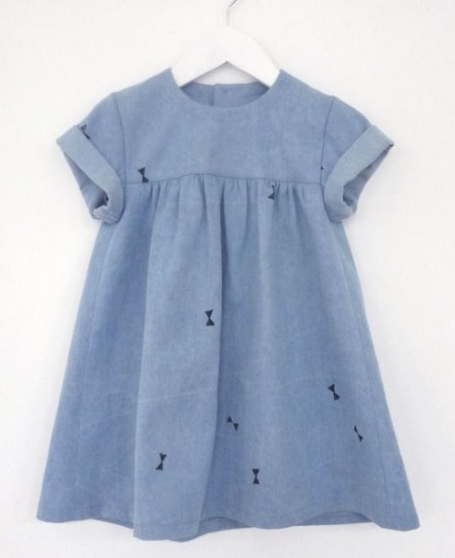 This  Oh My Kids babydoll denim dress  is an adorable heavyweight denim dress with a washed look and a hand-printed bows all-over print (bow prints are also trending in children's wear this spring).