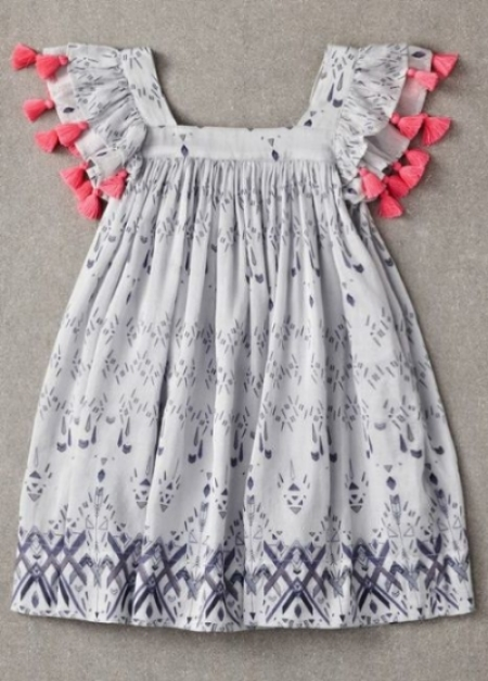 This  Nellystella Chloe Dress Tribal Print  is 70% cotton and 30% silk, which is soft and luxurious fabric your daughter will love wearing. This Dress can be dressed up with Fancy Sandals, or worn for everyday wear with Birkenstocks. I love the tassels on the flutter sleeves of this Pretty Dress.